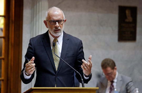 FILE - In this Jan. 27, 2016 file photo, State Sen. Travis Holdman, R-Markle, speaks at the Statehouse in Indianapolis. Holdman, who drafted legislation in 2013 that would have barred undercover video filming at the state's farms says video exposing alleged animal abuse at a northwestern Indiana dairy farm is politically motivated. Holdman says he's undecided about refiling the bill during next year's session. An animal rights group released disturbing footage Tuesday, June 4, 2019, showing Fair Oaks Farm workers kicking and throwing young calves.