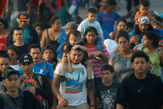Hundreds of Central American migrants walk together on the highway, after crossing the Guatemala – Mexico border, near Ciudad Hidalgo, Mexico, Wednesday, June 5, 2019. State and local police provided a security escort to the migrants as they walked along a highway leading from the border to the first major city in Mexico, Tapachula.