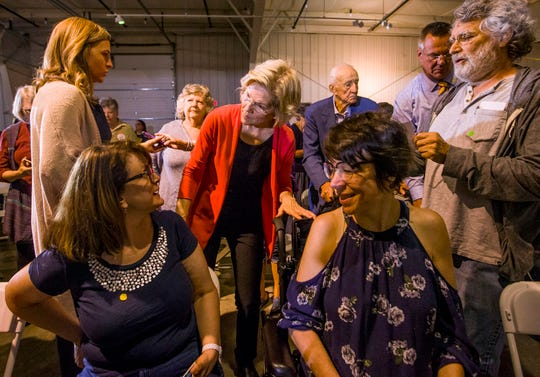 Democratic presidential candidate Elizabeth Warren speak to Lisa Flynn Scroggins, of South Bend, left, and Wendy Silver, of Bristol, during her Elkhart Community Conversation event on Wednesday, June 5, 2019, at the RV/MH Hall of Fame and Museum in Elkhart, Ind.