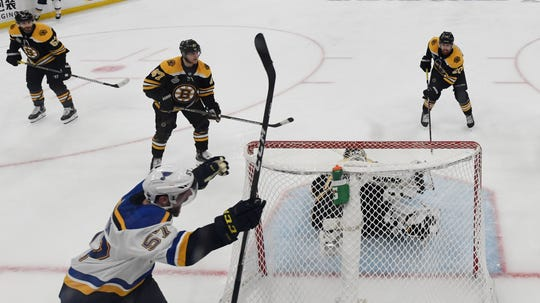 Game 5: St. Louis Blues left wing David Perron (57) celebrates after scoring a goal past Boston Bruins goaltender Tuukka Rask during the third period.