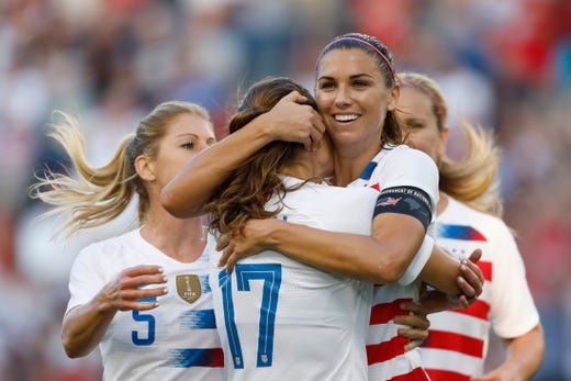 In this July 26, 2018, file photo, U.S. forward Alex Morgan, second from right, celebrates her hat trick with defender Tobin Heath (17) and other teammates during the second half of a Tournament of Nations soccer match against Japan in Kansas City, Kan. The Women's World Cup kicks off Friday, June 7, 2019, in Paris.