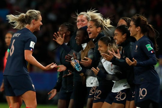 France's Amandine Henry (left) reacts after scoring a goal during the opening match between France and South Korea.