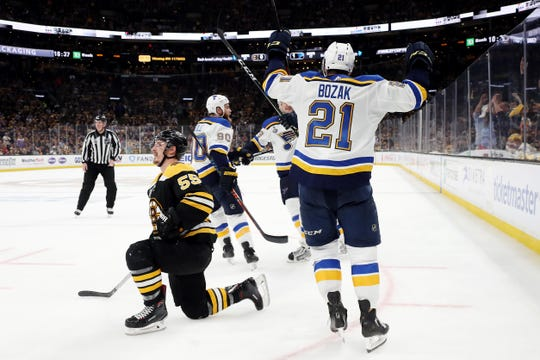 Stanley Cup Final: St. Louis Blues forward Tyler Bozak, who wasn't called for a trip on the Boston Bruins' Noel Acciari, celebrates a goal by David Perron.