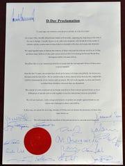 President Donald Trump puts his John Hancock on a multi-national D-Day proclamation.