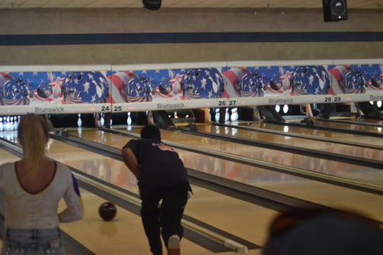 Peabody boys basketball coach Charles Smith (right) participates in the Louisiana Sports Hall of Fame bowling event Friday at Four Seasons Bowling Center.