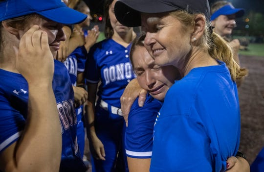 Head Coach Debbie hugs senior Mya Lamicella  as they celebrate their win. Donovan Catholic Girls Softball shuts out Cedar Grove in NJSIAA Tournament of Champions game at Seton Hall University on June 7, 2019.