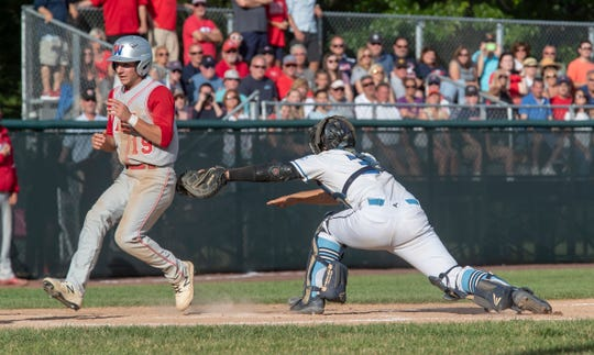 Wall's Alfredo DiPaola gets past the seventh inning tag attempt for the 10th Wall run of game. Wall Twp. High School Baseball defeats West Morris Central 10-2 in NJSIAA State Group 3 Baseball Championship in Hamilton, NJ on June 8, 2019.