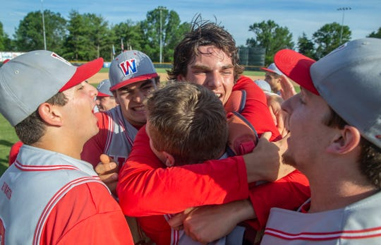 Trey Dombroski (center) celebrates state championship with team mates. Wall Twp. High School Baseball defeats West Morris Central 10-2 in NJSIAA State Group 3 Baseball Championship in Hamilton, NJ on June 8, 2019.
