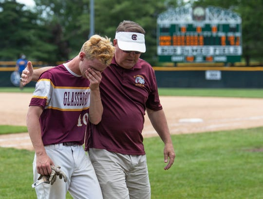 Glassboro's Drew Tongue is consoled after an 8-5 loss to Emerson Boro in the Group 1 final on Saturday at Veterans Park in Hamilton.