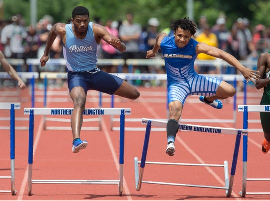 NJSIAA Track and Field Meet of Champions takes place at Northern Burlington High School.  Freeholds Felix Lawrence , left, takes second as North Brunswick's Rami Berberena wins the 400 hurdles event. Columbus, NJ Saturday, June 08, 2019