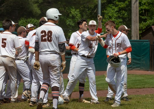 Pascack Hills celebrate their two runs in the sixth inning. Pascack Hills baseball defeats Point Pleasant Boro 2-0 in NJSIAA State Group 2 Baseball Championship in Hamilton, NJ on June 8, 2019.