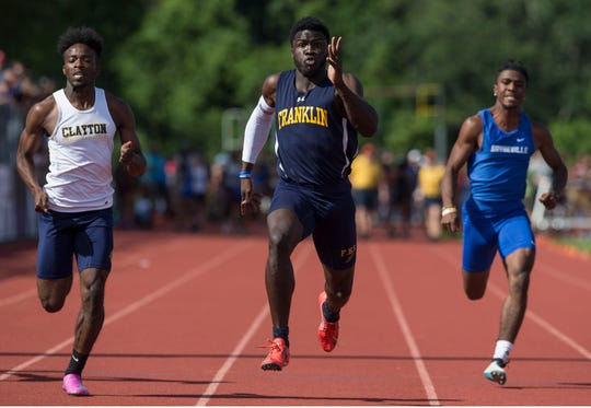 NJSIAA Track and Field Meet of Champions takes place at Northern Burlington High School. Mario Heslop, Franklin wins the boys 100 dash. 
