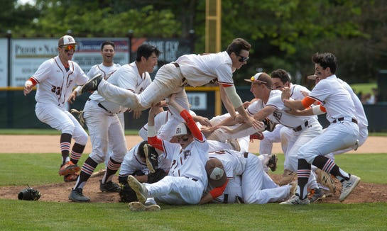 The Pascack Hills baseball team celebrates after a 2-0 win over Point Pleasant Boro that gave the Cowboys their second straight NJSIAA State Group 2 championship in Hamilton on Saturday, June 8, 2019.