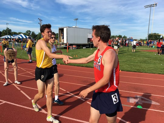 Point Boro's Devin Hart, left, congratulates runner-up Jack Stanley of Mendham after Hart won the 3200 at the Meet of Champions.