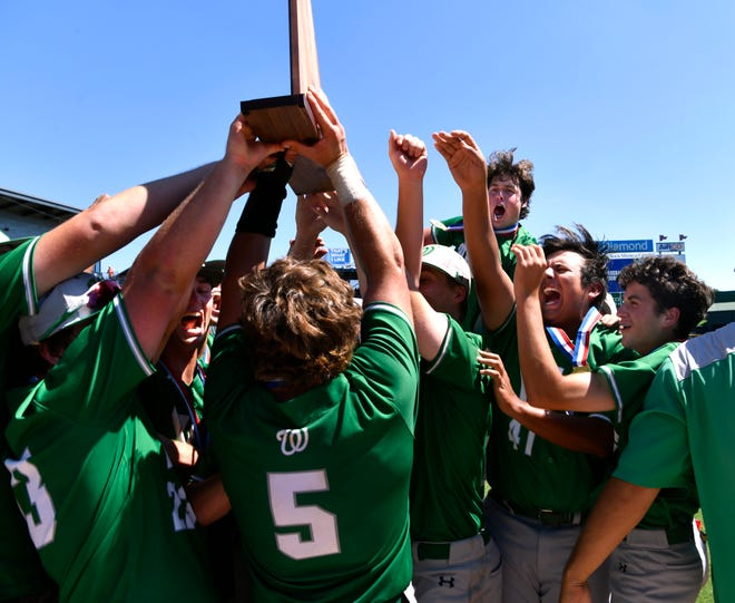 Members of the Wall Hawks celebrate winning the UIL Class 3A baseball state championship trophy after Saturday's game against Blanco in Round Rock June 8, 2019. Final score was 2-1.