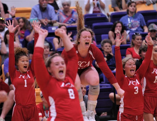 Brownwood's Torrey Miller, center, and the Red team celebrate a 24-26, 25-19, 25-17 victory at the FCA All-Star volleyball match Saturday, June 8, 2019, at Wylie's Bulldog Gym.