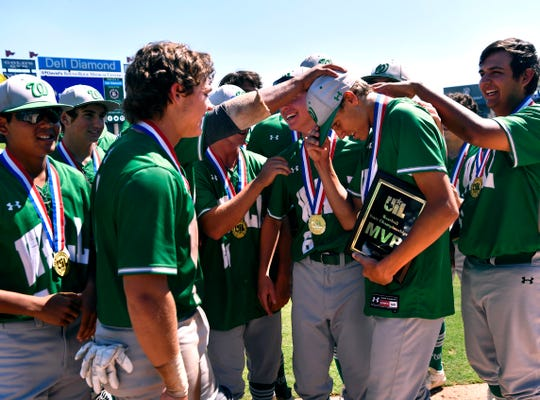 Wall teammates congratulate pitcher Luke Young after he was named Most Valuable Player after the Hawk's win against Blanco in Saturday's UIL Class 3A state baseball championship June 8, 2019. Final score in Round Rock was 2-1.