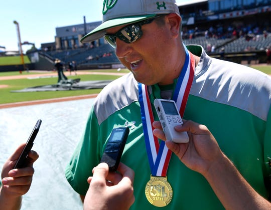 Wall coach Jason Schniers speaks with reporters after his team won the UIL Class 3A baseball state championship 2-1 against Blanco in Round Rock on June 8, 2019.