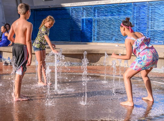 Kids playing at Wave Park during the 2019 National Cereal Festival in downtown Battle Creek on Saturday, June 8, 2019.
