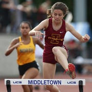 Ithaca's Lucia Sibley competes in the 400 Meter Hurdles during the New York State Track Championships in Middletown on June 7, 2019.