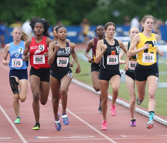 At right, Corning's Lindsey Butler leads the pack in the 800 Meter Run during the New York State Track Championships in Middletown on June 7, 2019.