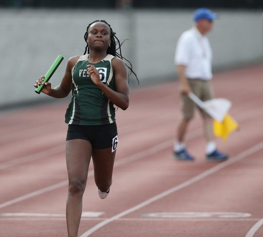 Vestal's Tia Jones crosses the finish line in the 4x100 Meter Relay during the New York State Track Championships in Middletown on June 7, 2019.