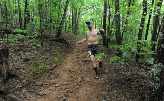 Black Mountain Monster runners faced wet, muddy conditions as they navigated the course on June 8. The 24-hour race was stopped seven hours short of its conclusion by organizers, who cited safety concerns.