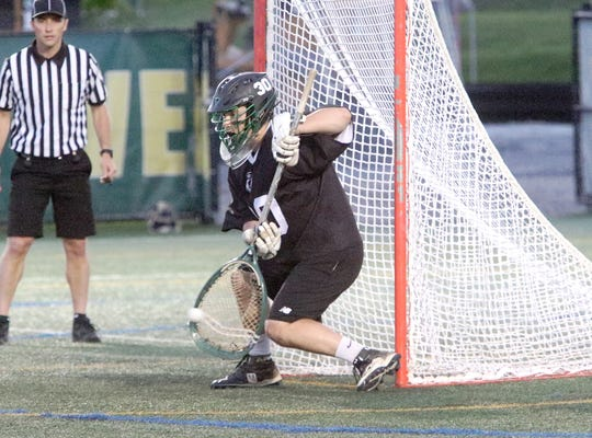 Stowe goalie Nathan Rice makes a save during Stowe's 9-7 win in the D2 State Championship game at UVM on Friday night.