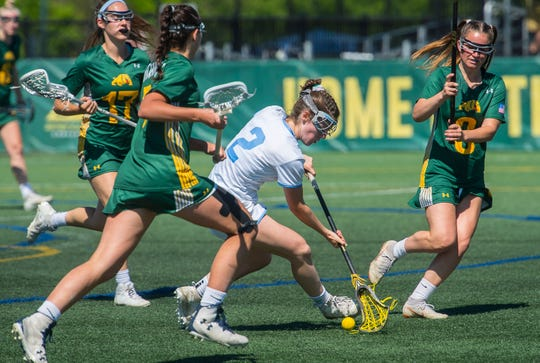 South Burlington's #2 Kate Hall scoops up the loose ball from Burr and Burton Academy during the Vermont state girls lacrosse championship held at UVM in Burlington on Saturday, June 8, 2019. South Burlington won, 8-7.