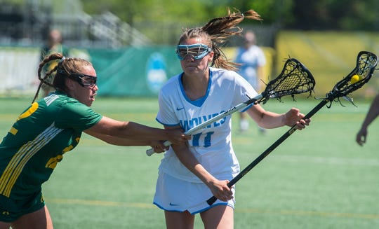 South Burlington's #11 Christina March tries to get past Burr and Burton Academy #12 Olivia Watanabe during the Vermont state girls lacrosse championship held at UVM in Burlington on Saturday, June 8, 2019. South Burlington won, 8-7.