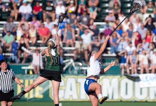 St. Johnsbury's Lilly Leach and Vergennes/Mount Abraham's Grace Harvey vie for a draw in the Division II high school girls lacrosse championship game at Virtue Field on Friday, June 7, 2019.