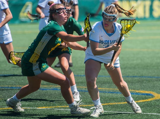 South Burlington's #2 Kate Hall tries to get past the Burr and Burton Academy defense during the Vermont state girls lacrosse championship held at UVM in Burlington on Saturday, June 8, 2019. South Burlington won, 8-7.
