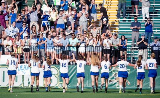 Fans cheer on the Vergennes/Mount Abraham players after their 10-9 win against St. Johnsbury in the Division II high school girls lacrosse championship game at Virtue Field on Friday, June 7, 2019.