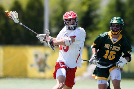 CVU's Sam Sturim (15) runs past Burr and Burton's Patrick Forstmann (15) with the ball during the boys DI high school lacrosse championship game between the Burr and Burton Bulldogs and the Champlain Valley Union Redhawks at Virtue Field on Saturday morning June 8, 2019 in Burlington, Vermont.
