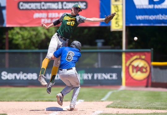 White River Valley first baseman Timber Russell (20) leaps to catch an errant throw over Vergennes' Robbie Bicknell in the Division III high school baseball championship game at Centennial Field on Saturday, June 8, 2019.