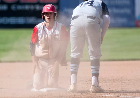 Champlain Valley's Jonah Roberts steals third base safely in the Division I high school baseball state championship game at Centennial Field on Saturday, June 8, 2019.