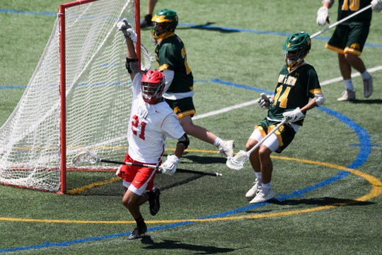 CVU's Noah Martin (21) celebrates after scoring a goal during the boys DI high school lacrosse championship game between the Burr and Burton Bulldogs and the Champlain Valley Union Redhawks at Virtue Field on Saturday morning June 8, 2019 in Burlington, Vermont.