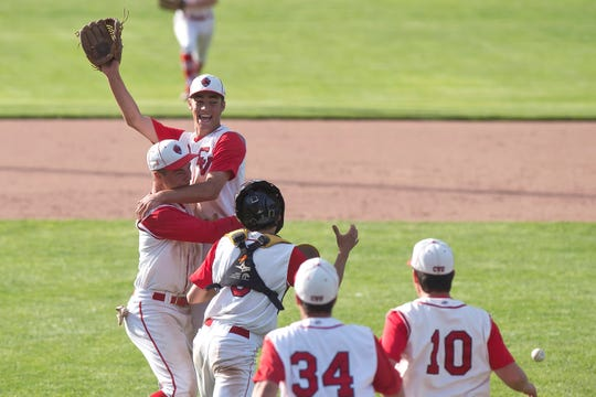 Champlain Valley pitcher Ian Parent is picked up by Aidan Johnson after the final out in the Redhawks 5-2 win in the Division I high school baseball state championship game at Centennial Field on Saturday, June 8, 2019.