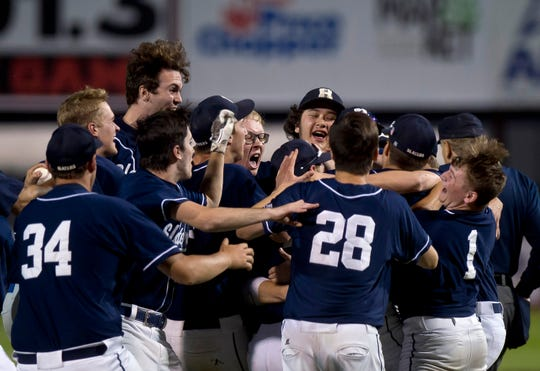 The Fair Haven Slaters celebrate after their 3-1 win over Otter Valley in the Division II high school baseball championship at Centennial Field on Friday night, June 7, 2019.