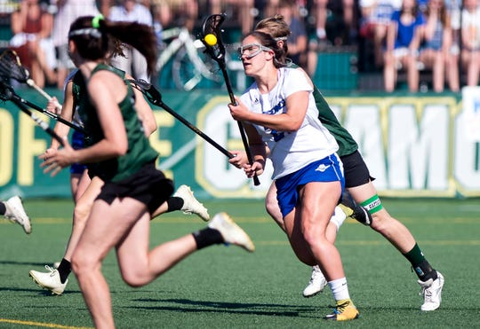 Vergennes/Mount Abraham's Grace Harvey charges up the field with the ball in the Division II high school girls lacrosse championship game at Virtue Field on Friday, June 7, 2019.