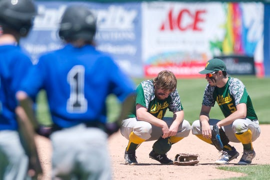 White River Valley's George Carr, right, consoles Logan Martin during the fourth inning in the Division III high school baseball championship game at Centennial Field on Saturday, June 8, 2019.
