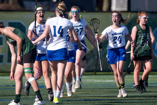 Vergennes/Mount Abraham players react to scoring a goal in the dying seconds of the first half in the Division II high school girls lacrosse championship game at Virtue Field on Friday, June 7, 2019.