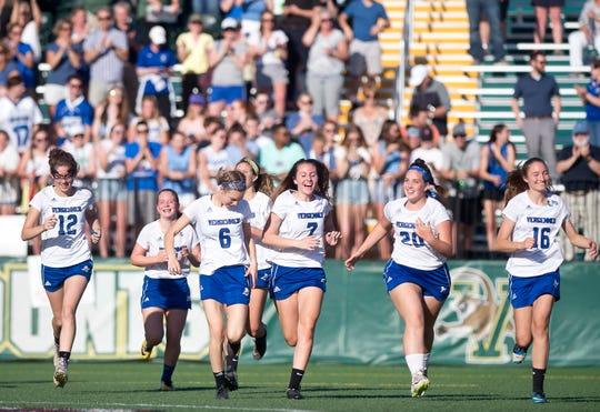 Vergennes/Mount Abraham players celebrate their 10-9 win over St. Johnsbury in the Division II high school girls lacrosse championship game at Virtue Field on Friday, June 7, 2019.