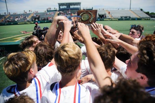 CVU celebrate the championship during the boys DI high school lacrosse championship game between the Burr and Burton Bulldogs and the Champlain Valley Union Redhawks at Virtue Field on Saturday morning June 8, 2019 in Burlington, Vermont.