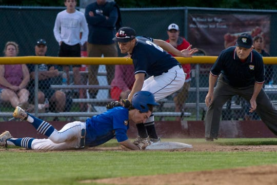 Otter Valley's Reilly Shannon, left, is safe at third base under the tag of Fair Haven's Andrew Lanthier during the Division II high school baseball championship at Centennial Field on Friday night, June 7, 2019.