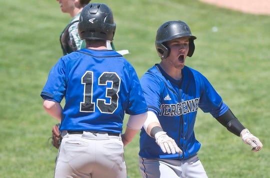 Vergennes' Jeffrey Stearns, right, celebrates with his brother Tucker Stearns (13) after both scored in the Division III high school baseball championship game at Centennial Field on Saturday, June 8, 2019.