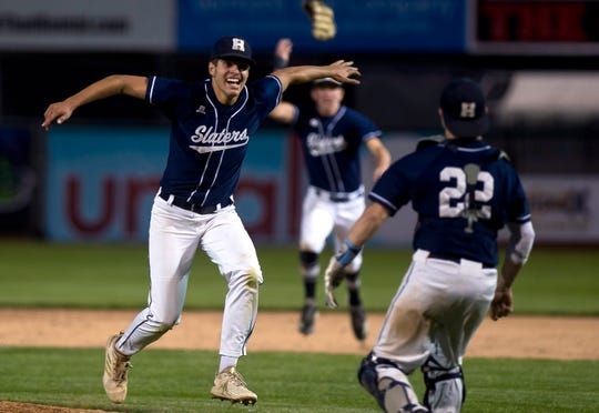 Fair Haven pitcher Aubrey Ramey, left, looks to celebrate with catcher Dylan Lee after the final out of their 3-1 win over Otter Valley in the Division II high school baseball championship at Centennial Field on Friday night, June 7, 2019.