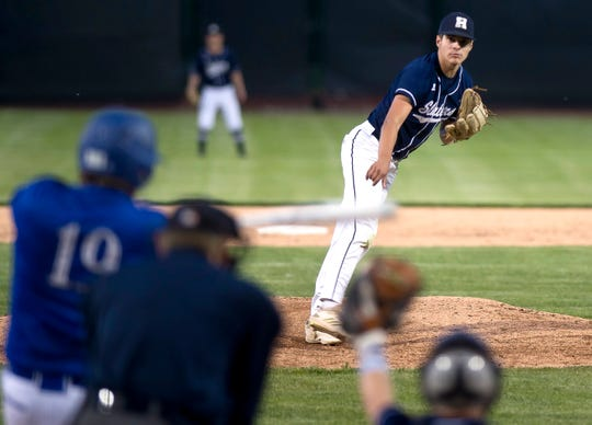 Fair Haven pitcher Aubrey Ramey, right, fires to the plate during the Division II high school baseball championship at Centennial Field on Friday night, June 7, 2019.