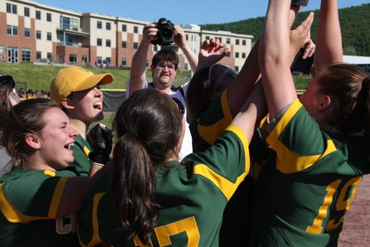 BFA celebrates after winning the D-I softball championship in Castleton on Saturday.