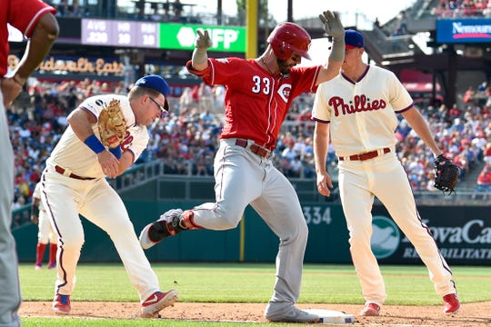 Jun 8, 2019; Philadelphia, PA, USA; Cincinnati Reds right fielder Jesse Winker (33) collides with Philadelphia Phillies first baseman Rhys Hoskins (left) after Hoskins makes the tag out during the fifth inning at Citizens Bank Park. Mandatory Credit: Derik Hamilton-USA TODAY Sports